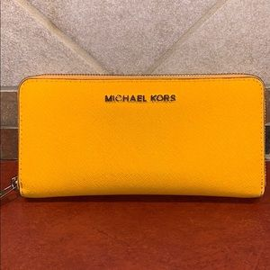 MICHAEL KORS yellow/orange zip around wallet